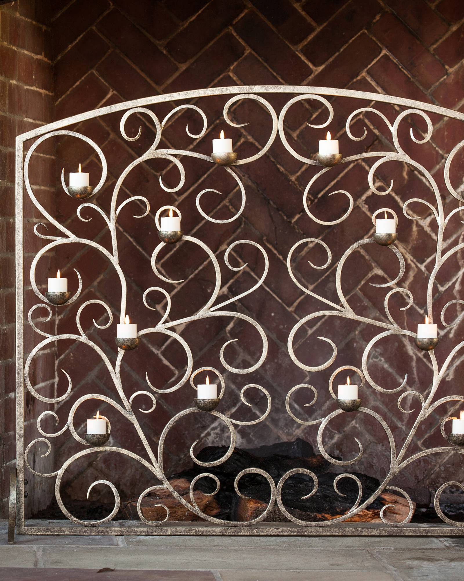 Make this decorative Tea Light Hearth Fireplace Screen the focal point of the room even during warmer seasons and enjoy flickering flames all year.